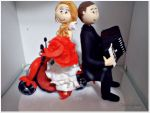 Valor R$ __________  código: 279 noiva pilotando a biz(de biscuit)  e noivo de carona tocando gaita