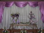 Mesa decorativa do bolo de casamento em tons lilás.Doc.3-BQ