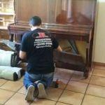 Transporte de piano, desmontagem e içamento