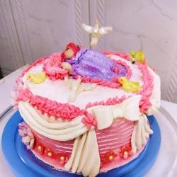 bolo de batizado rosa espatulado.