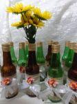 Centro de mesa garrafa decorada - 7,00 A UNID. Não acompanha girassóis.